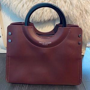 Burgundy coloured handbag